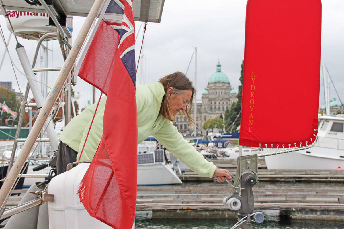 Jeanne Socrates does some last-minute tune-ups in the Victoria Causeway Marina before departing for an eight-month sail around the world. (Keili Bartlett/News staff)
